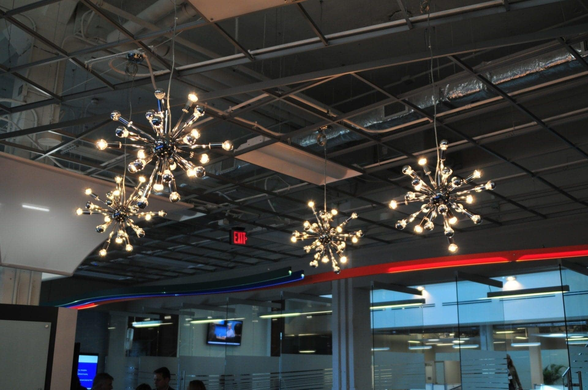 Custom multi bulb chandelier corporate environment