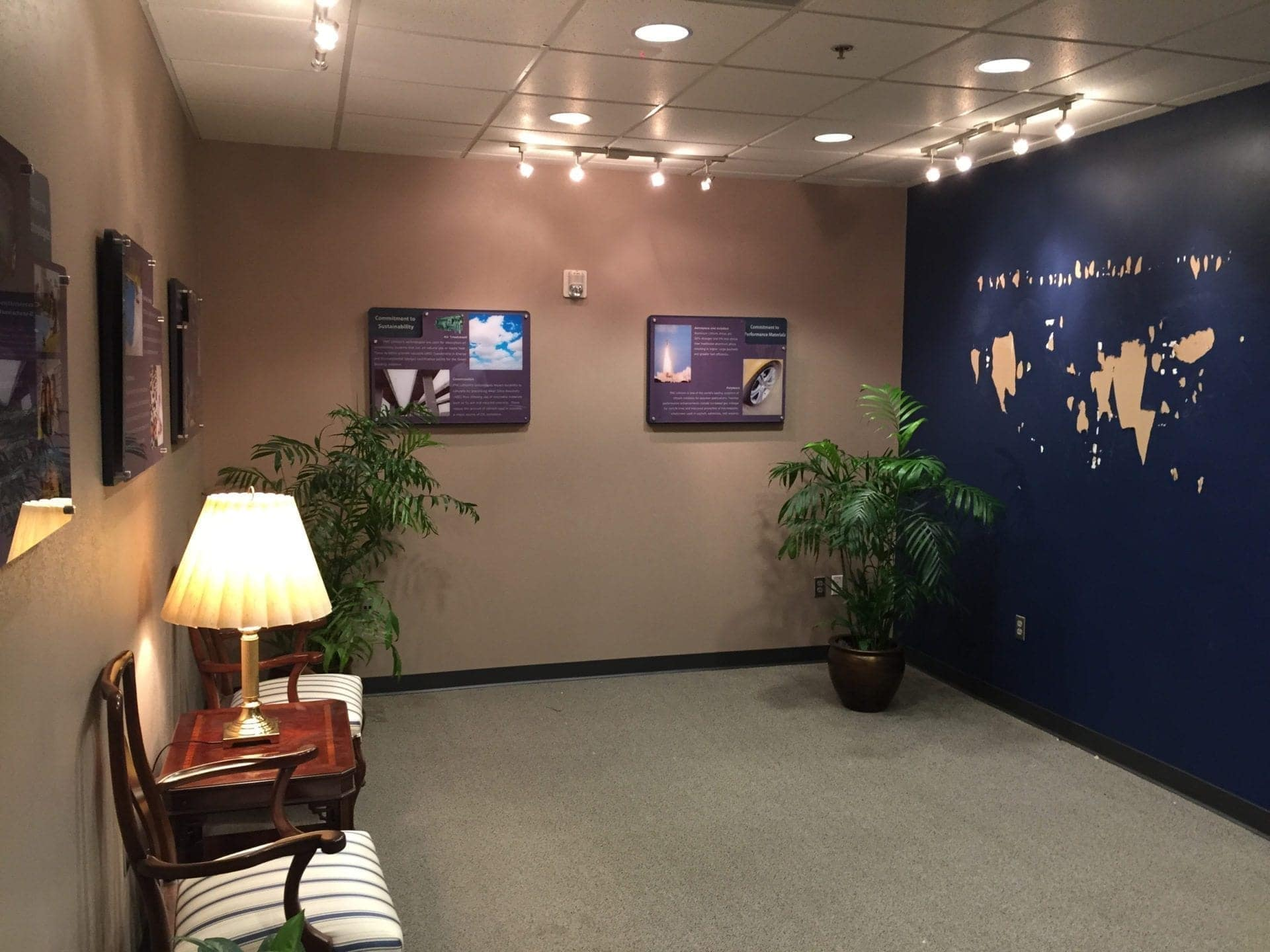 Installation progress of informational acrylic mounted graphics and 3D wall mounted world map