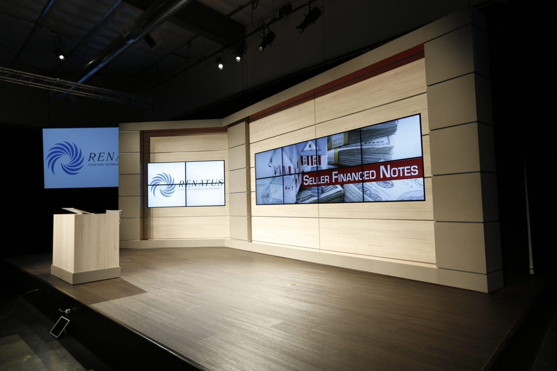Renatus audio visual studio set with custom millwork podium and set backdrop with recessed digital display array
