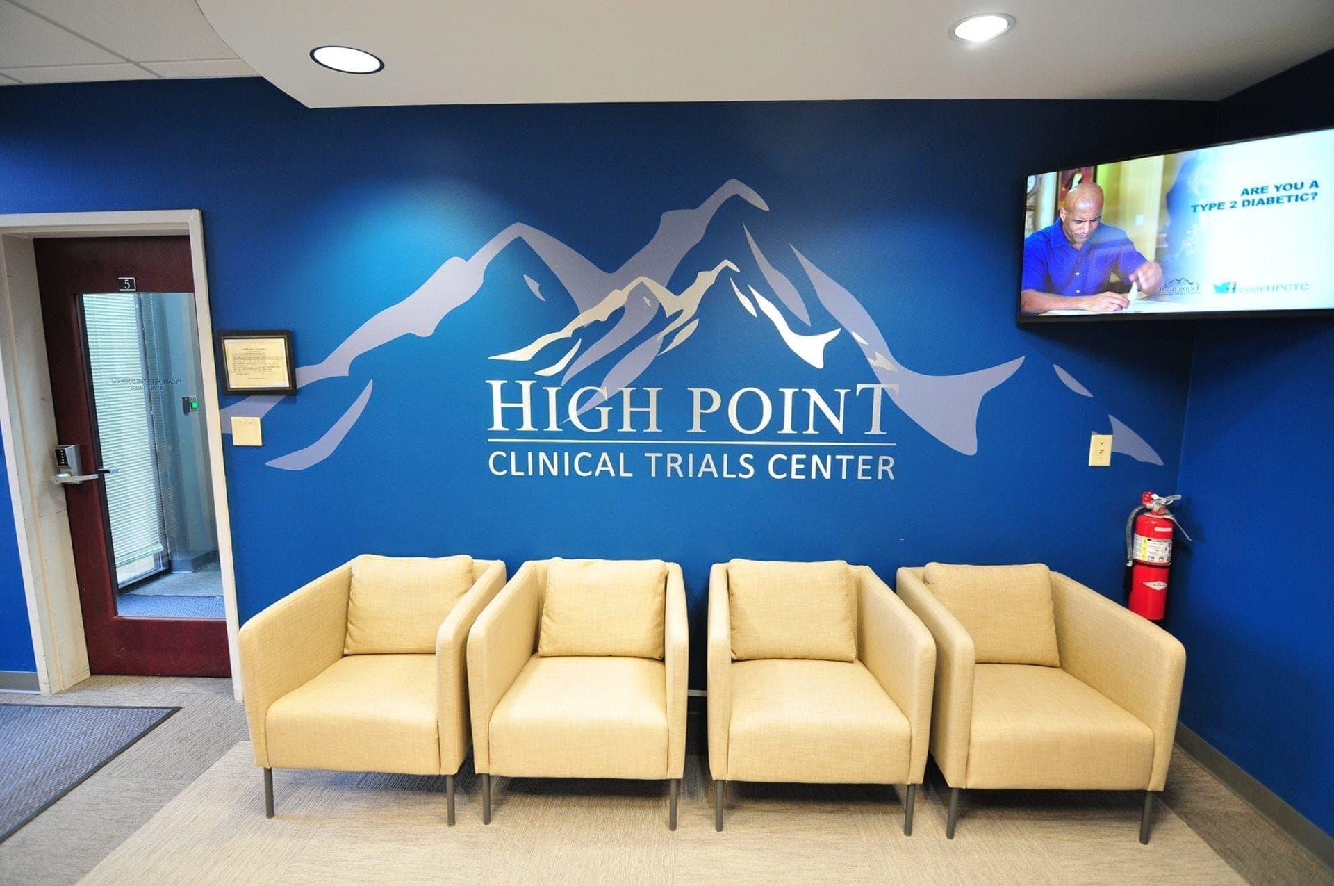 High Point Clinical Trials Center newly rebranded lobby with custom vinyl graphic and corporate furniture