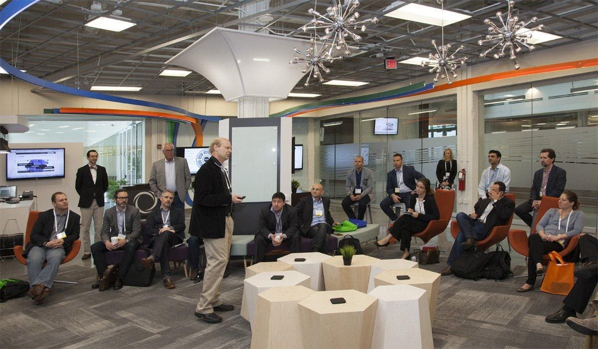 Innovation lab at Inmar with custom organic shape table and indoor tension fabric clouds architecture