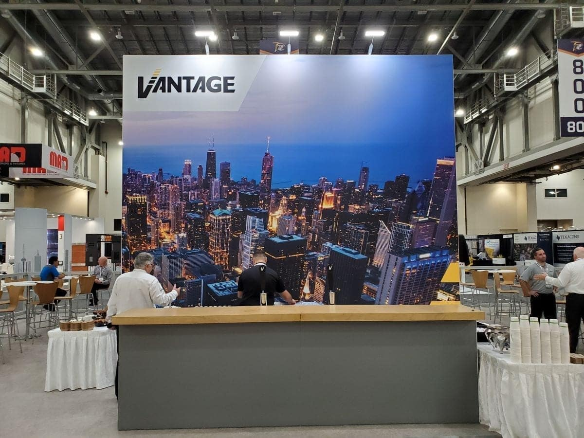 Vantage Elevation NAEC trade show exhibit bar with custom fabricated countertop and large vinyl graphics